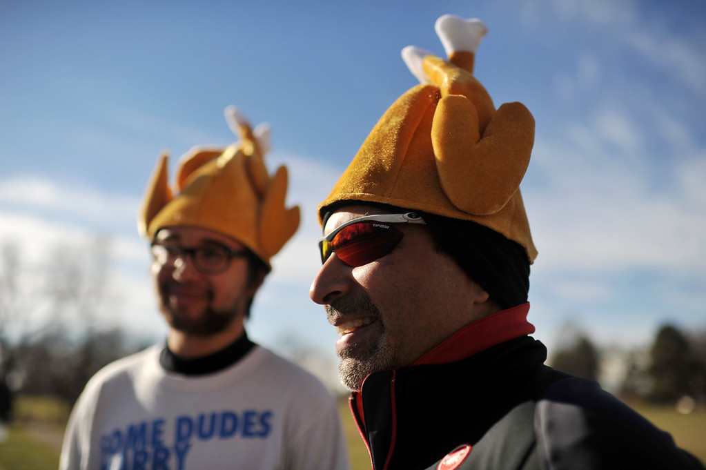 . Robert Feliciano, right, and his son Ben put their turkey hats on for the 40th Annual Turkey Trot in Washington Park in Denver, Colorado on November 28, 2013. Denver\'s largest Thanksgiving Day run benefits United Way and goes for 4 miles. (Photo by Hyoung Chang/The Denver Post)