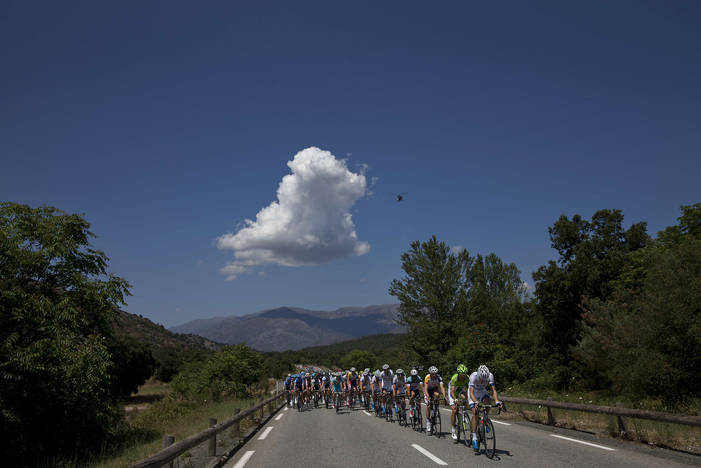 . The pack rides during the 156 km second stage of the 100th edition of the Tour de France cycling race on June 30, 2013 between Bastia and Ajaccio, on the French Mediterranean Island of Corsica.    JEFF PACHOUD/AFP/Getty Images