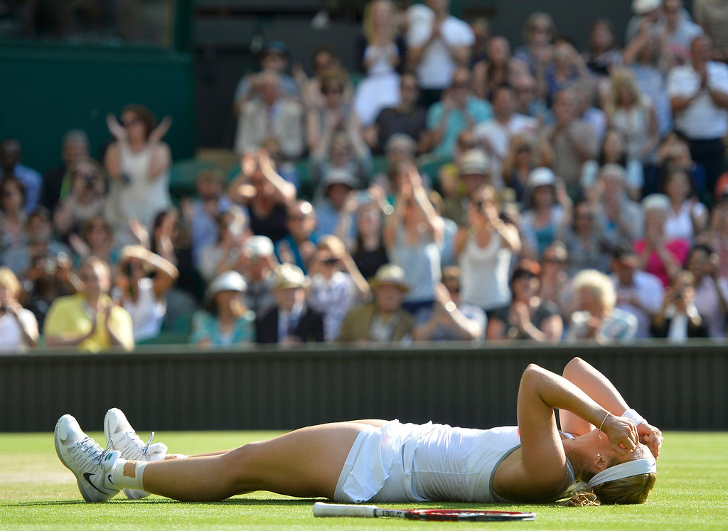 . Sabine Lisicki of Germany celebrates after defeating Agnieszka Radwanska of Poland in their women\'s semi-final tennis match at the Wimbledon Tennis Championships, in London July 4, 2013.   REUTERS/Toby Melville