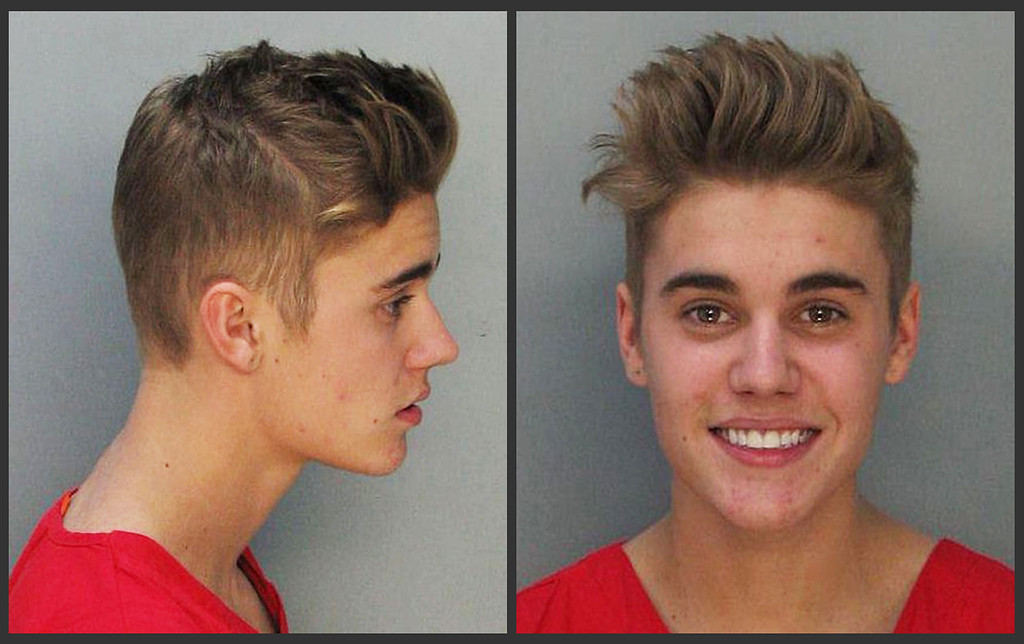. These police booking mugs made available by the Miami Dade County Corrections Department show pop star Justin Bieber, Thursday, Jan. 23, 2014. Bieber and singer Khalil were arrested early Thursday for allegedly drag-racing on a Miami Beach Street. Police say Bieber has been charged with resisting arrest without violence in addition to drag racing and DUI. Police also say the singer told authorities he had consumed alcohol, smoked marijuana and taken prescription drugs. (AP Photo/Miami Dade County Jail)