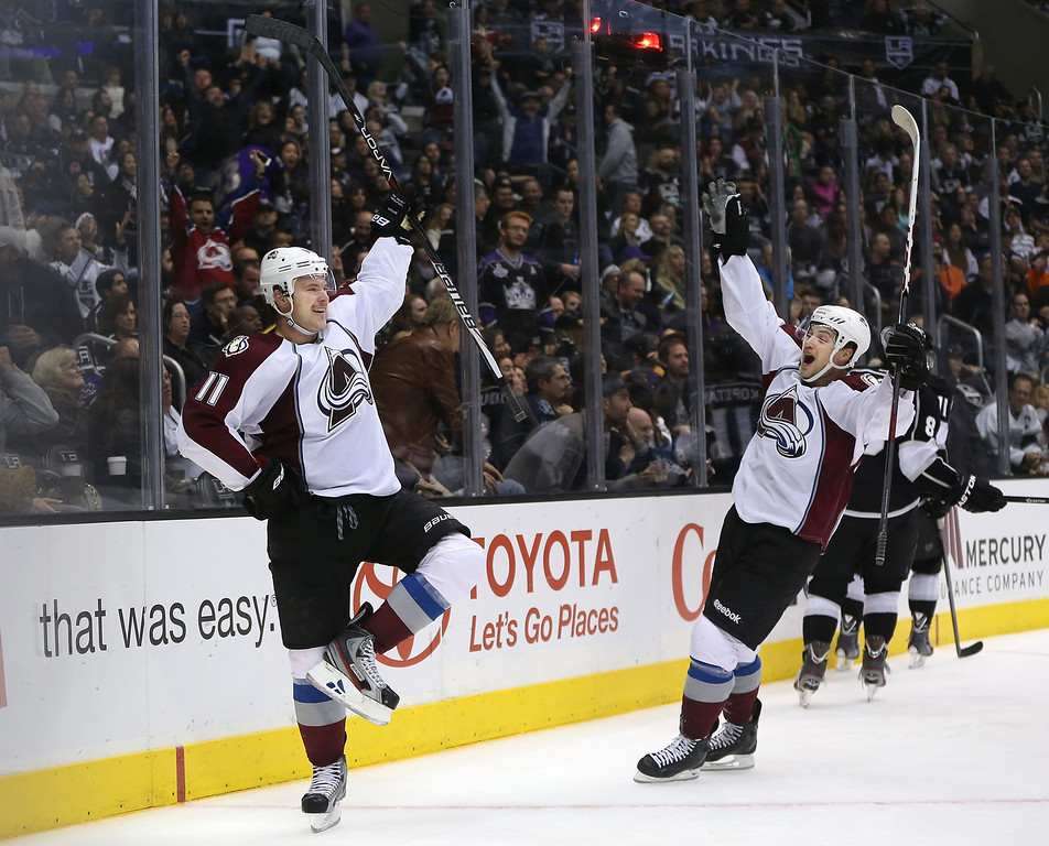 . LOS ANGELES, CA - NOVEMBER 23:  Jamie McGinn #11 and John Mitchell #7 of the Colorado Avalanche react after McGinn scored in overtime to defeat the Kings 1-0 in the NHL game at Staples Center on November 23, 2013 in Los Angeles, California.  (Photo by Victor Decolongon/Getty Images)