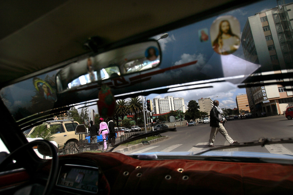 . ADDIS ABABA, ETHIOPIA - APRIL 27: Pictures of Jesus are seen in a taxi as it makes its way through the streets of the Ethiopian capital Addis Ababa on April 27, 2007.  Jews are a minority in the predominantly Christian and Muslim country. Some 2,500 Ethiopians of Jewish origin remain in the East African country as Israel slowly brings them over, a few dozen at a time, on commercial flights. Since 1984, more than 73,000 Ethiopian Jews have been settled in Israel. (Photo by Uriel Sinai/Getty Images)
