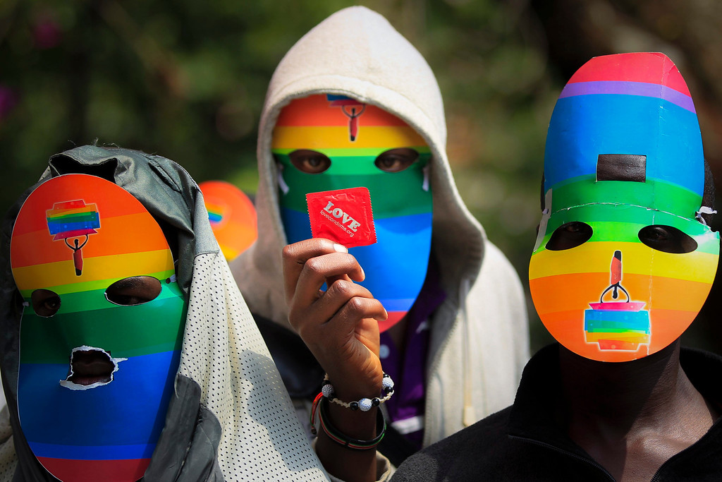 . A file picture dated 10 Februatry  2014 shows a masked Kenyan supporter of the LGBT community holding a condom as he joins others in protest against Uganda\'s anti-gay bill in front of the Ugandan High Commission in Nairobi, Kenya. Uganda\'s President Yoweri Museveni signed into law on 24 February 2014 anti-gay legislation that allows homosexuals to be punished with up to life in prison. The law has come under strong criticism abroad, with US President Barack Obama warning that it could \'complicate\' Uganda\'s relations with one of its biggest aid donors.  EPA/DAI KUROKAWA