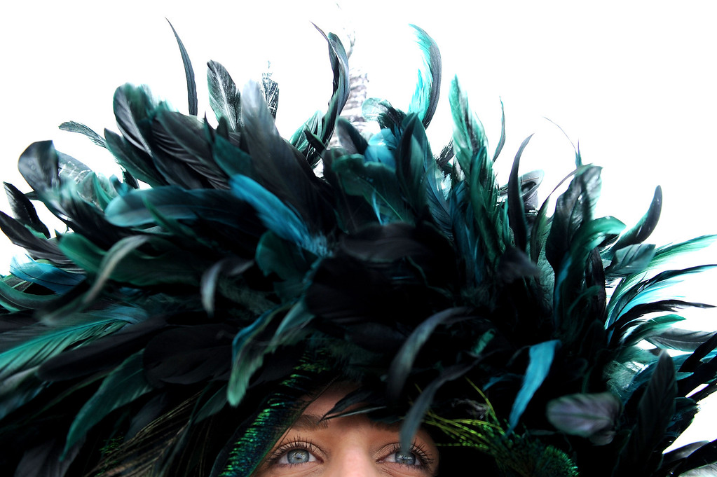 . BALTIMORE, MD - MAY 18:  A detailed view of a feathered hat on a race fan in the infield prior to the 138th running of the Preakness Stakes at Pimlico Race Course on May 18, 2013 in Baltimore, Maryland.  (Photo by Patrick Smith/Getty Images)