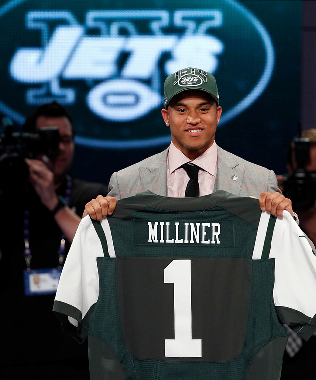 . Dee Milliner from the University of Alabama stands with a New York Jets jersey after being selected by the Jets as the ninth overall pick in the 2013 National Football League (NFL) Draft at Radio City Music Hall in New York, April 25, 2013. REUTERS/Adam Hunger