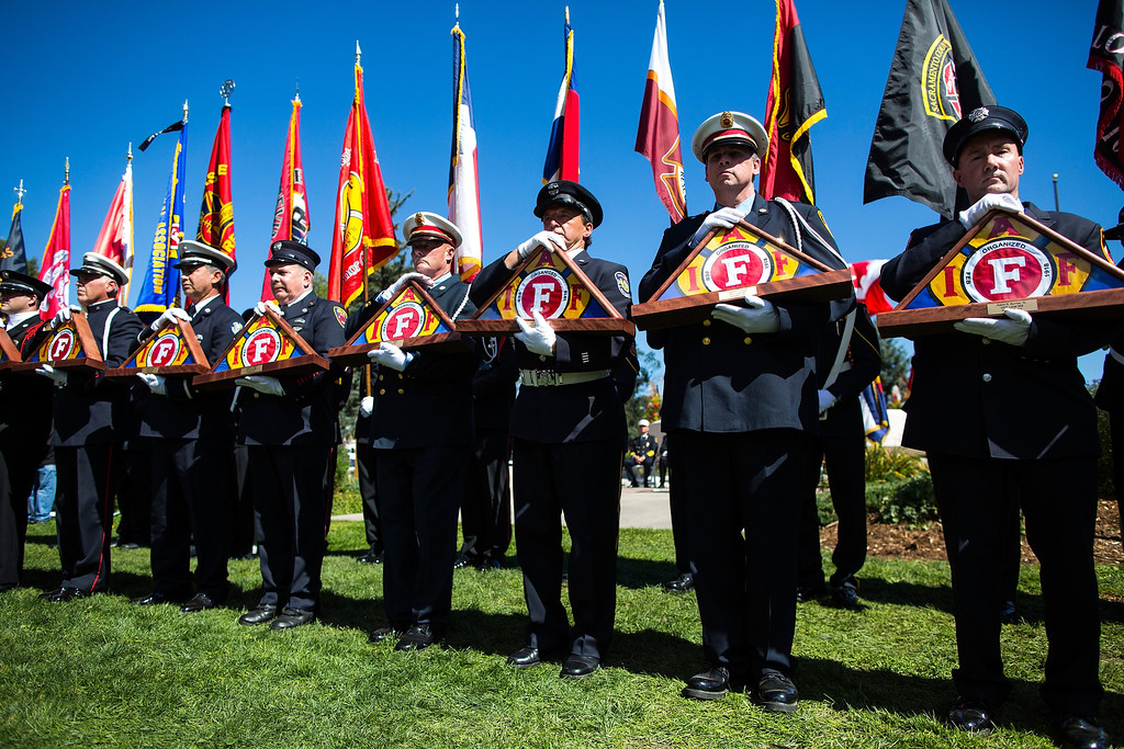 . Members of the IAFF Honor Guard hold flags for firefighters who lost in the line of duty during the annual IAFF Fallen Fire Fighter Memorial at Memorial Park in Colorado Springs, Colo., on Saturday, Sept. 21, 2013.(AP Photo/The Gazette, Kent Nishimura)
