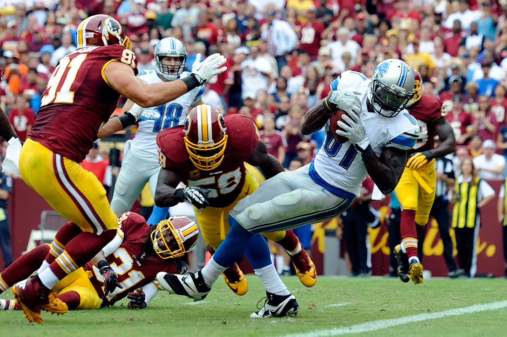 . LANDOVER, MD - SEPTEMBER 22:  Calvin Johnson #81 of the Detroit Lions scores a touchdown in the fourth quarter during a game against the Washington Redskins at FedExField on September 22, 2013 in Landover, Maryland.  (Photo by Patrick McDermott/Getty Images)