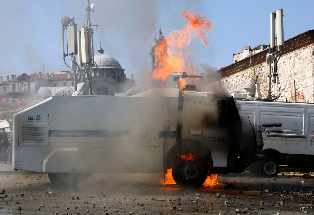 . A riot police water cannon is set on fire by protesters during clashes between police and anti-government protesters at Istanbul\'s Taksim square June 11, 2013. REUTERS/Yannis Behrakis