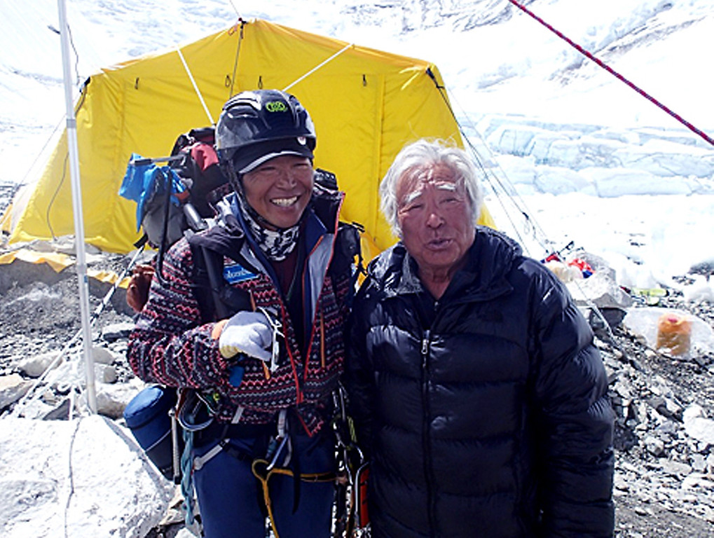 . Eighty-year-old Japanese adventurer Yuichiro Miura, right, is greeted by his friend climber Kenji Kondo while resting at his camp at 6,500 meters (21,325 feet) during his attempt to scale the summit of Mount Everest. (AP Photo/Miura Dolphins)