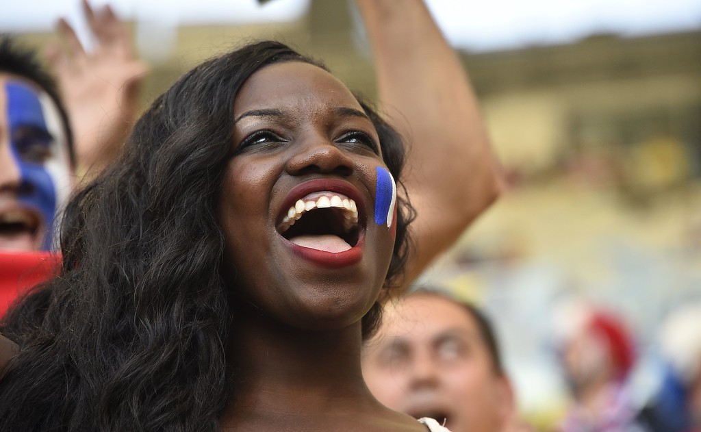 . A French supporter cheers prior to the start of a Group E football match between Ecuador and France at the Maracana Stadium in Rio de Janeiro during the 2014 FIFA World Cup on June 25, 2014.       AFP PHOTO / RODRIGO  BUENDIA/AFP/Getty Images