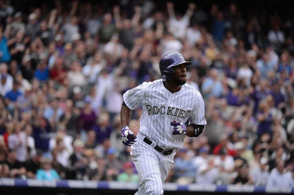 . Dexter Fowler (24) of the Colorado Rockies homers to right in the fifth inning. (Photo by Hyoung Chang/The Denver Post)