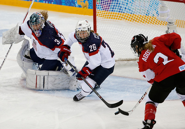 PHOTOS: USA vs Canada in Women's Hockey At Sochi 2014 Winter Olympics