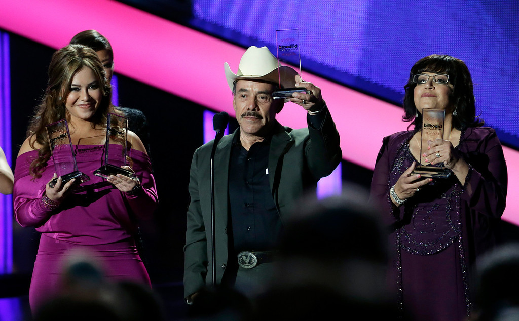 . The family of singer Jenni Rivera hold the late singer\'s awards, including artist of the year, at the Latin Billboard Awards in Coral Gables, Fla., Thursday April 25, 2013. Rivera perished in a plane crash last year. (AP Photo/Alan Diaz)