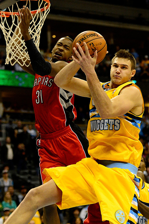 . Denver Nuggets small forward Danilo Gallinari (8) grabs a rebound against the Toronto Raptors during the second half of the Nuggets\' 113-110 win at the Pepsi Center on Monday, December 3, 2012. AAron Ontiveroz, The Denver Post