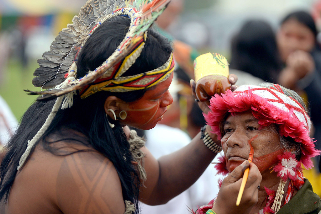 . Indigenous Brazilians are seen during a demonstration by Greenpeace activists and indigenous citizens near government buildings in Brasilia on October 1, 2013. Numerous demonstrations are planned by several indigenous ethnic groups in the Brazilian capital, as they demand more support from the federal government. AFP PHOTO / Evaristo SA/AFP/Getty Images