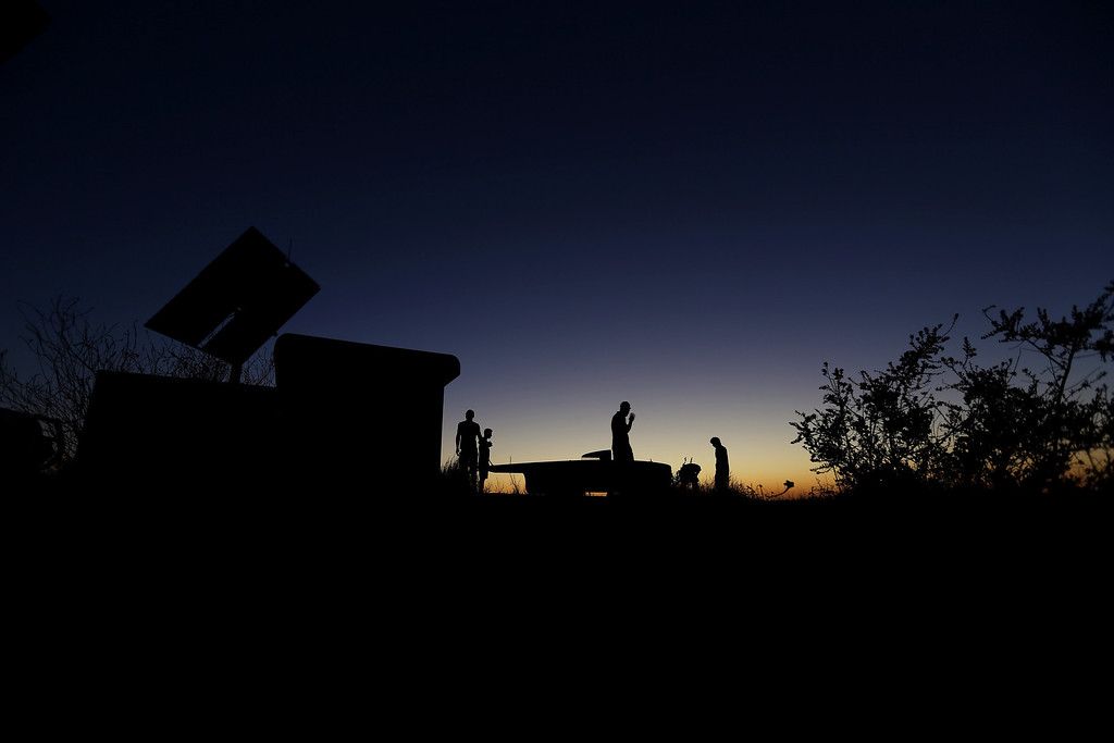 . ALICE SPRINGS, AUSTRALIA - OCTOBER 09:  The team of Arrow1 from Team Arrow, Associated with Queensland University of Technology in Australia prepare to position the car in the pre-dawn light to catch the sunrise light before racing on Day 4 on October 9, 2013 between Alice Springs and Kulgera, Australia. Over 25 teams from across the globe are competing in the 2013 World Solar Challenge - a 3000 km solar-powered vehicle race between Darwin and Adelaide. The race began on October 6th with the first car expected to cross the finish line on October 10th.  (Photo by Mark Kolbe/Getty Images)