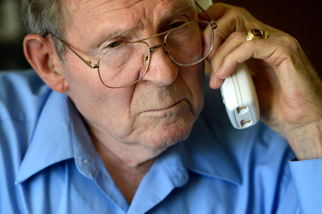 """. AURORA, CO. - May 22: Bob Crowell in his Aurora home listens as Governor John Hickenlooper on a conference call with other family members of Nathan Dunlap\'s crimes announces he granted the death row inmate a \""""temporary reprieve\"""" from the death penalty May 22, 2013 Aurora, Colorado. (Photo By Joe Amon/The Denver Post)"""