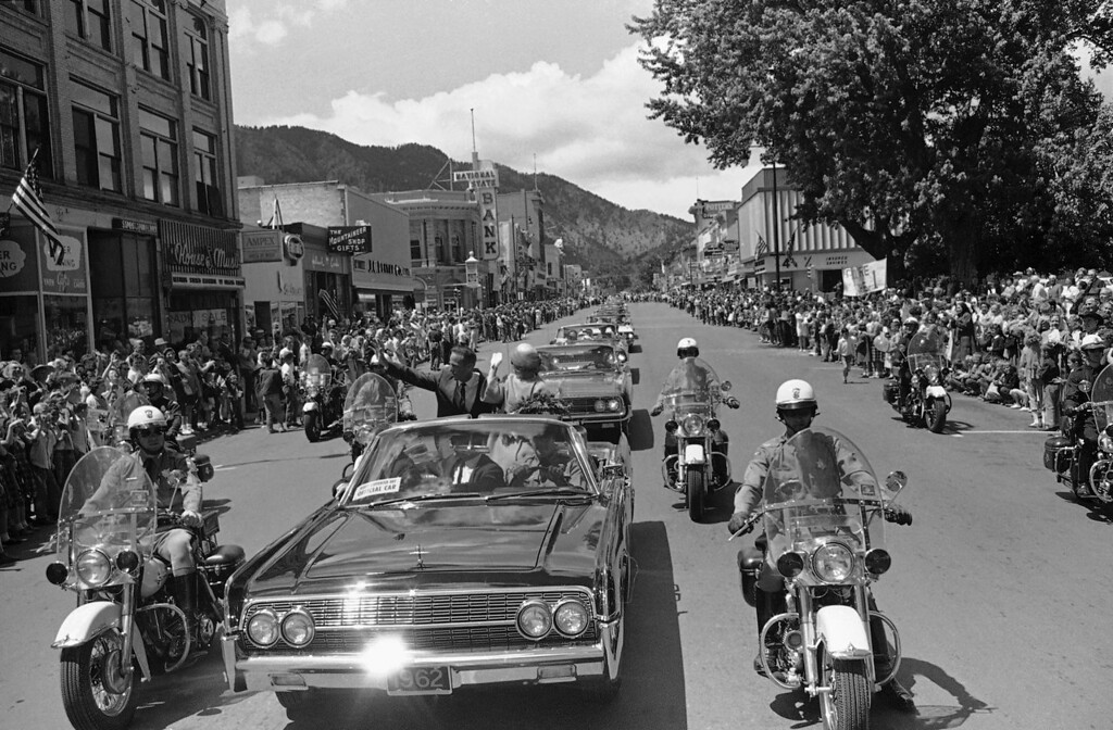 . Astronaut Scott Carpenter and his wife, Renee acknowledge applause from the crowd as he heads a parade down the main street of his home town of Boulder on May 29, 1962. He spent a night in Boulder and will take part in a Memorial Day parade in Denver. (AP Photo)