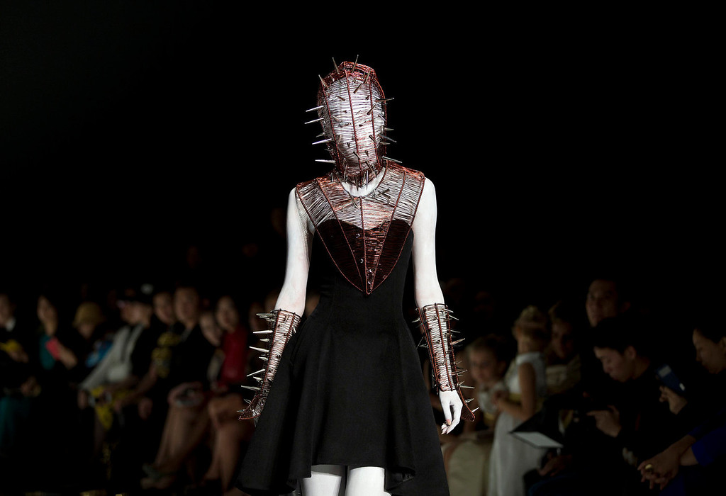 . A Chinese model presents a creation by Chinese designer Hu Sheguang on stage during the China Fashion Week in Beijing Tuesday, Oct. 29, 2013. (AP Photo/Andy Wong)