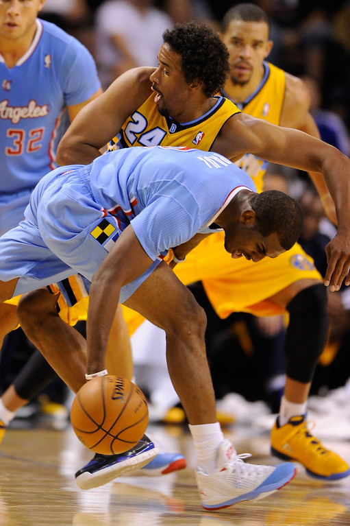 . Chris Paul #3 of the Los Angeles Clippers collides with Andre Miller #24 of the Denver Nuggets during their preseason game at the Mandalay Bay Events Center on October 19, 2013 in Las Vegas, Nevada. Los Angeles won 118-111 in overtime.   (Photo by Ethan Miller/Getty Images)