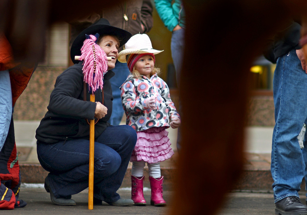 . Meg Littlepage, left, enjoy 107th National Western Stock Show Kick-Off Parade with her granddaughter Lillianne Bennet, 3, at Downtown Denver on Thursday, Denver. CO, January 10, 2013.  Hyoung Chang, The Denver Post