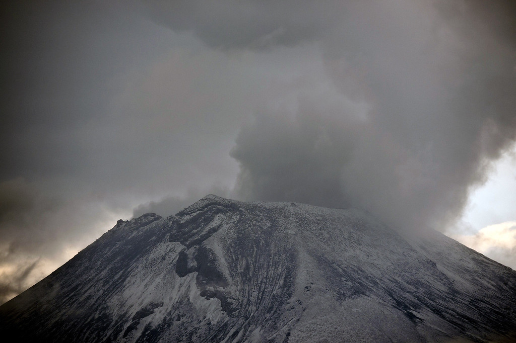 . Clouds of ash and smoke are spewed from the Popocatepetl Volcano as seen from Santiago Xalitxintla, in Puebla, Mexico, on May 13, 2013. According to a report by the National Center of Prevention of Disasters (CENAPRED) the yellow alert phase three is still in force. Ronaldo Schemidt/AFP/Getty Images