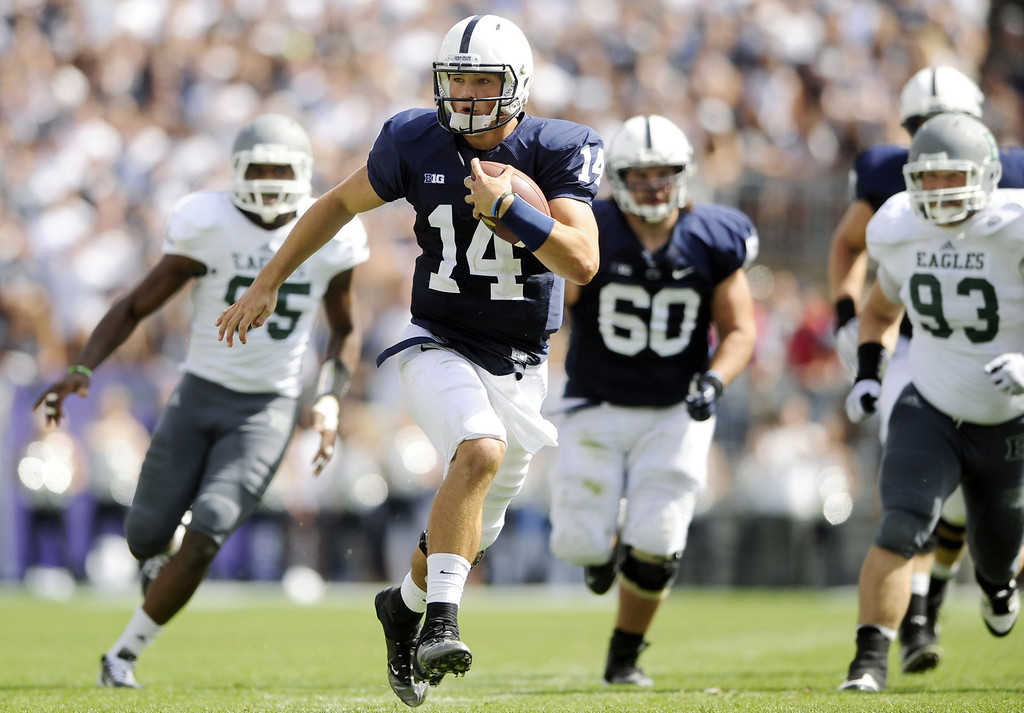 . Penn State\'s Christian Hackenberg carries the ball in the third quarter against Eastern Michigan during an NCAA college football game on Saturday, Sept. 7, 2013. Penn State defeated Eastern Michigan University 45-7 at Beaver Stadium. (AP Photo/York Daily Record/Sunday News, Chris Dunn)