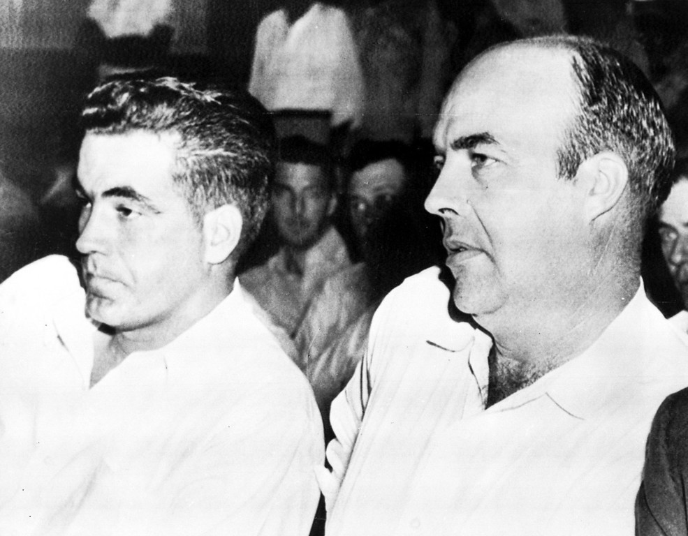 """. Inside the court during the murder trial against half-brothers Roy Bryant, left, and John W. Milam, in Sumner, Miss., Sept. 23, 1955. Bryant and Milam are charged with the murder of 14-year-old African American Emmett  L.Till from Chicago, who is alleged to have \""""wolf-whistled\"""" and made advances at Bryant\'s wife Carolyn.  (AP Photo)"""