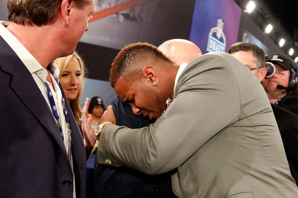 . Eric Ebron, from North Carolina, is congratulated after being selected 10th overall by  in the first round of the NFL football draft the Detroit Lions, Thursday, May 8, 2014, at Radio City Music Hall in New York. (AP Photo/Jason DeCrow)