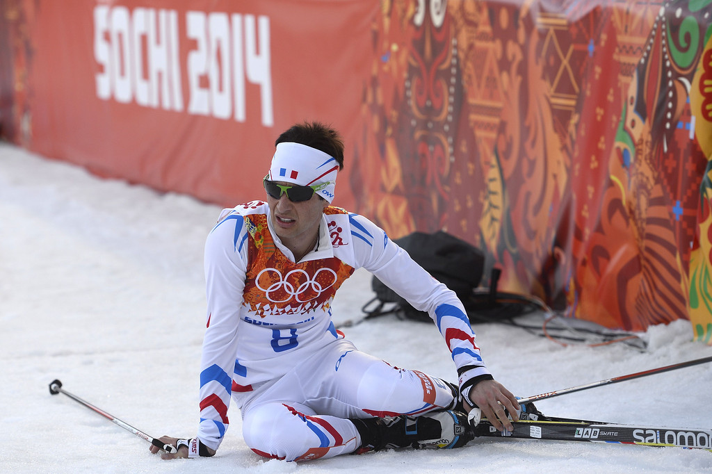 . France\'s Jason Lamy Chappuis sits on the snow at the finish of the Nordic Combined Individual NH / 10 km Cross-Country at the RusSki Gorki Jumping Center during the Sochi Winter Olympics on February 12, 2014, in Rosa Khutor near Sochi.   AFP PHOTO / PIERRE-PHILIPPE MARCOU/AFP/Getty Images