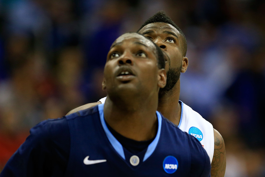 . KANSAS CITY, MO - MARCH 22:  (L-R) JayVaughn Pinkston #22 of the Villanova Wildcats and Reggie Bullock #35 of the North Carolina Tar Heels watch play in the first half during the second round of the 2013 NCAA Men\'s Basketball Tournament at the Sprint Center on March 22, 2013 in Kansas City, Missouri.  (Photo by Jamie Squire/Getty Images)
