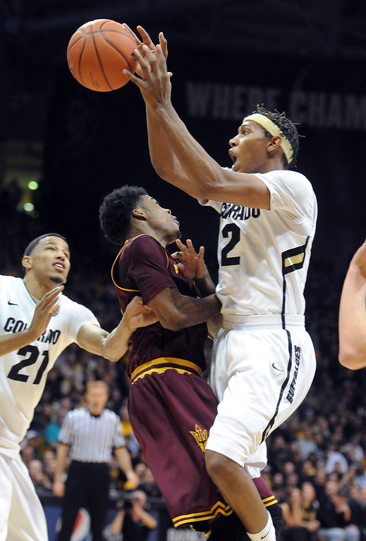. Colorado\'s Xavier Johnson, right, collides with Arizona State\'s Carrick Felix during the first half of an NCAA college basketball game on Saturday, Feb. 16, 2013, in Boulder, Colo. (AP Photo/Daily Camera, Cliff Grassmick)