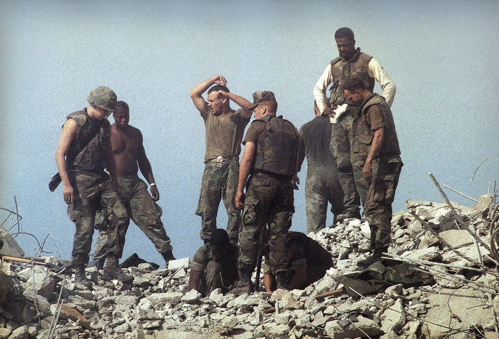 . In this Sunday, Oct. 23, 1983, file photo, service members search through rubble after a suicide truck bomb attack on the U.S. Marine barracks in Beirut, Lebanon. The blast _ the single deadliest attack on U.S. forces abroad since World War II _ claimed the lives of 241 American service members. (AP Photo/Jim Bourdier, File)