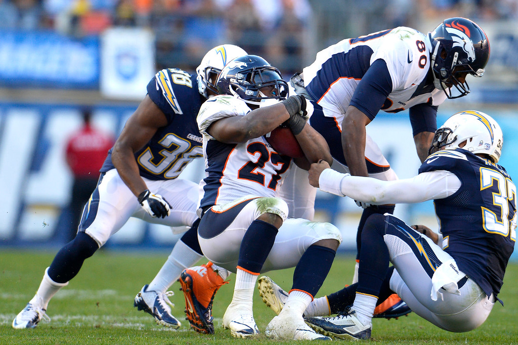 . Running back Knowshon Moreno #27 of the Denver Broncos driving back for more yardage in the second half vs the San Diego Chargers at Qualcomm Stadium November 10, 2013 San Diego, CA. (Photo By Joe Amon/The Denver Post)