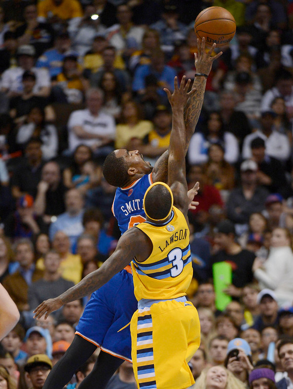 . J.R. Smith (8) of the New York Knicks goes up for a shot past Ty Lawson (3) of the Denver Nuggets during the second quarter March 13,  2013 at Pepsi Center. (Photo By John Leyba/The Denver Post)