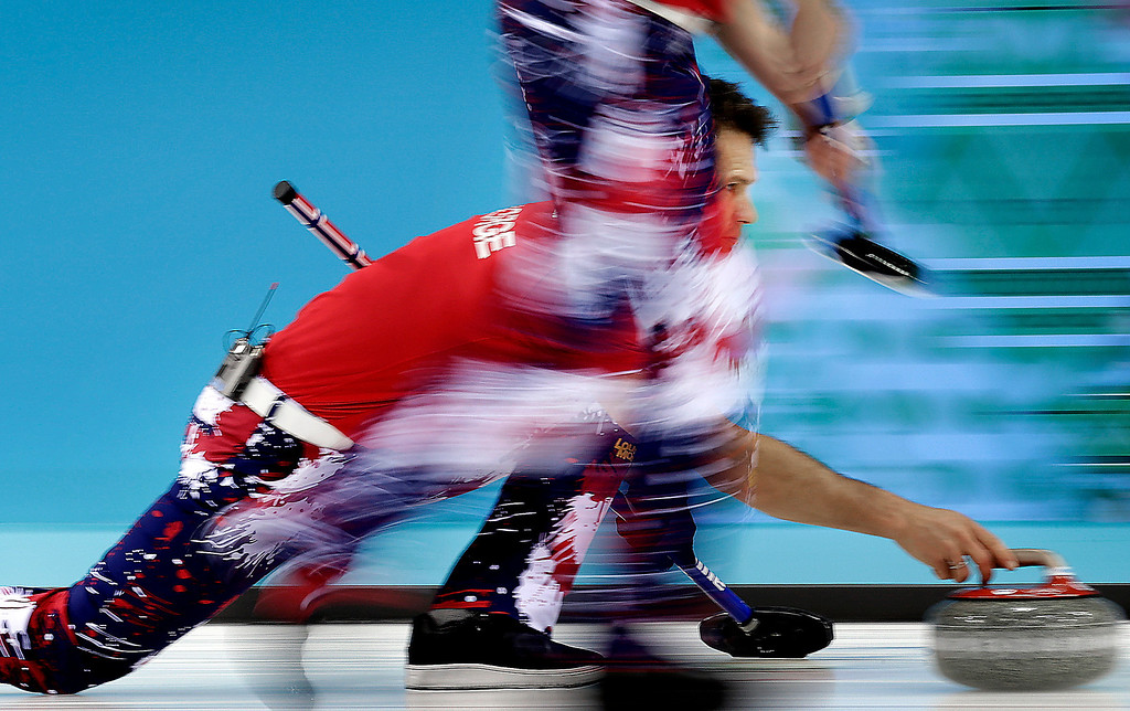 . Norway\'s Thomas Ulsrud releases the rock during the men\'s curling competition against Russia at the 2014 Winter Olympics, Tuesday, Feb. 11, 2014, in Sochi, Russia. (AP Photo/Wong Maye-E)