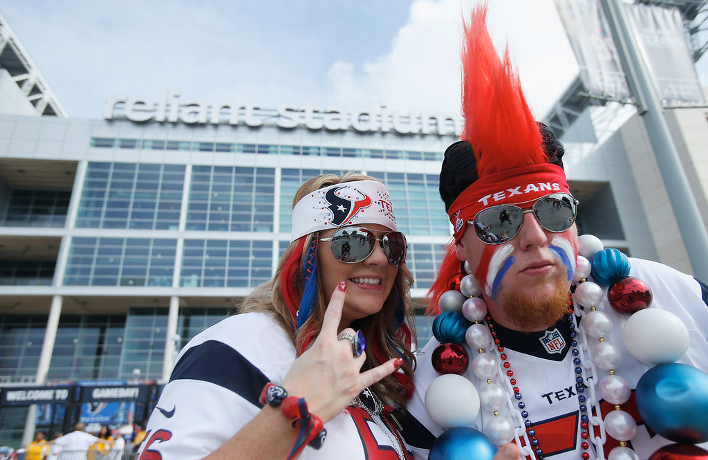 . Houston Texans fans pose outside the stadium prior to the start of the game against the Tennessee Titans at Reliant Stadium on September 15, 2013 in Houston, Texas.  (Photo by Scott Halleran/Getty Images)