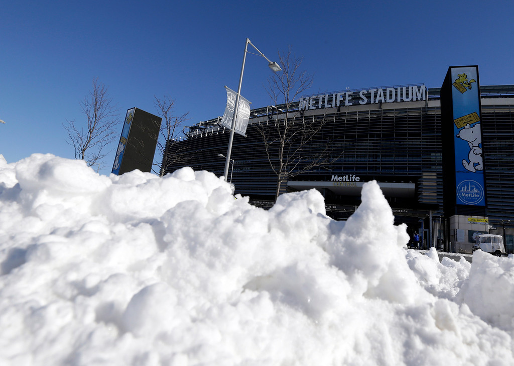 . Snow is accumulated near an entrance to MetLife Stadium following a snow storm, Wednesday, Jan. 22, 2014, in East Rutherford, N.J.  (AP Photo/Julio Cortez)