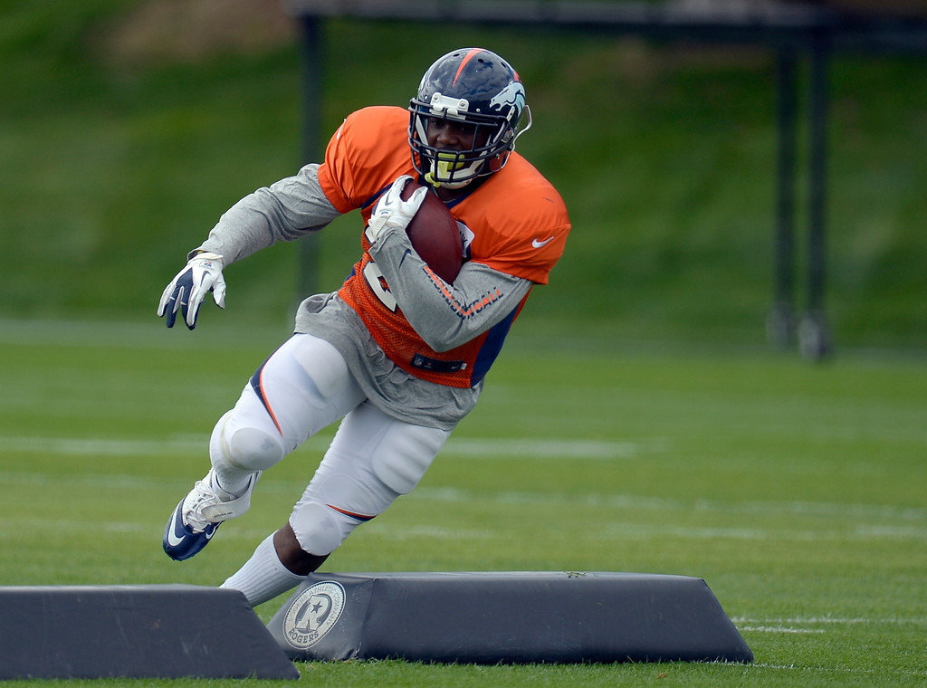 . Denver Broncos running back C.J. Anderson runs through drills during practice September 19, 2013 at Dove Valley. (Photo by John Leyba/The Denver Post)