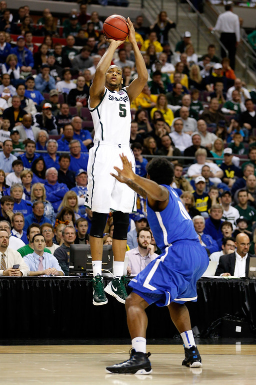 . AUBURN HILLS, MI - MARCH 23:  Adreian Payne #5 of the Michigan State Spartans attempts a shot against the Memphis Tigers during the third round of the 2013 NCAA Men\'s Basketball Tournament at The Palace of Auburn Hills on March 23, 2013 in Auburn Hills, Michigan.  (Photo by Gregory Shamus/Getty Images)