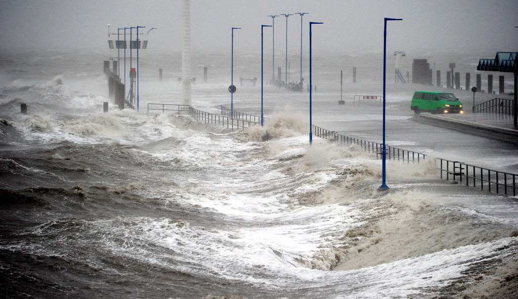 . Waves lash the ferry pier on the North Sea coast in Dagebuell, Germany, 05 December 2013. Storm front Xaver will reach full force later the afternoon.  EPA/CARSTEN REHDER
