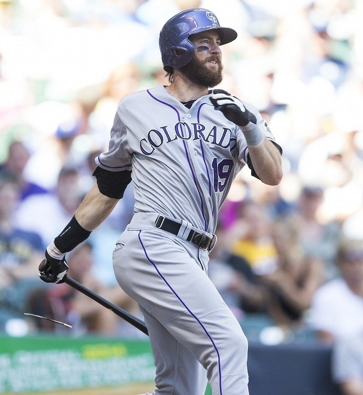. Charlie Blackmon #19 of the Colorado Rockies gets a single against the Milwaukee Brewers at Miller Park on June 29, 2014 in Milwaukee, Wisconsin.  (Photo by Tom Lynn/Getty Images)