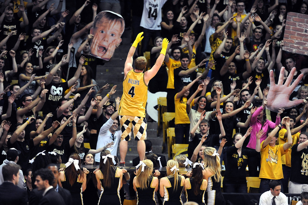 . One of the CU student section rituals during the  half of the January 27th, 2013  Cal game in Boulder. Cliff Grassmick/The Daily Camera