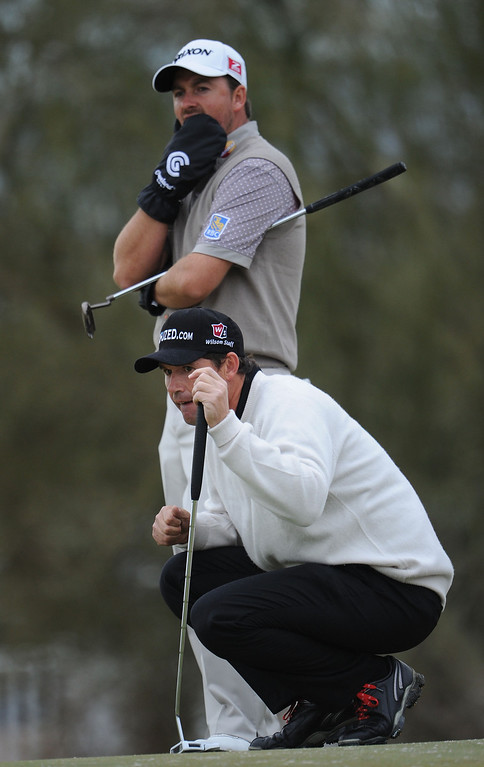 . MARANA, AZ - FEBRUARY 21:  Graeme McDowell of Northern Ireland watches as Padraig Harrington of Ireland lines up a putt during the first round of the World Golf Championships - Accenture Match Play at the Golf Club at Dove Mountain on February 21, 2013 in Marana, Arizona. Round one play was suspended on February 20 due to inclimate weather and is scheduled to be continued today.  (Photo by Stuart Franklin/Getty Images)