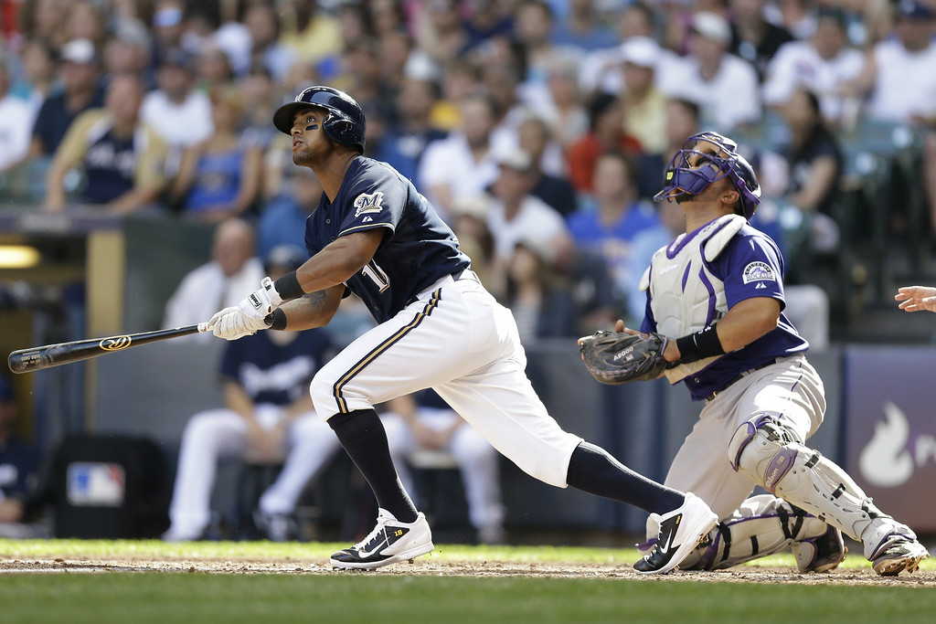 . MILWAUKEE, WI - JUNE 28: Khris Davis #18 of the Milwaukee Brewers hits a double in the bottom of the sixth inning against the Colorado Rockies at Miller Park on June 28, 2014 in Milwaukee, Wisconsin. (Photo by Mike McGinnis/Getty Images)