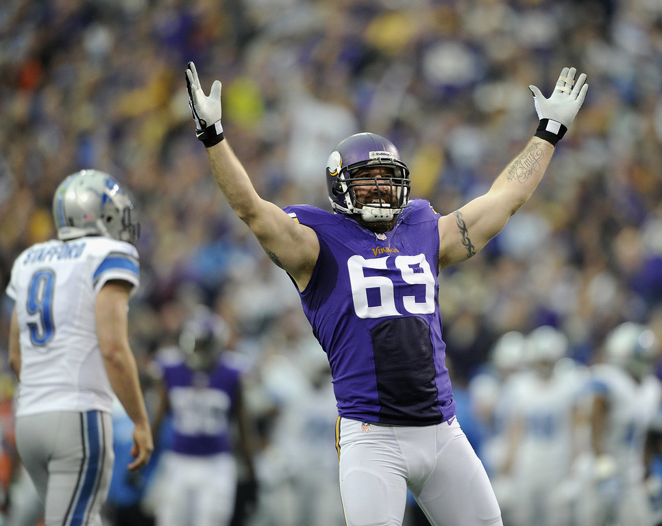 . Jared Allen #69 of the Minnesota Vikings celebrates a sack as Matthew Stafford #9 of the Detroit Lions looks on during the first quarter of the game on December 29, 2013 at Mall of America Field at the Hubert H. Humphrey Metrodome in Minneapolis, Minnesota. (Photo by Hannah Foslien/Getty Images)