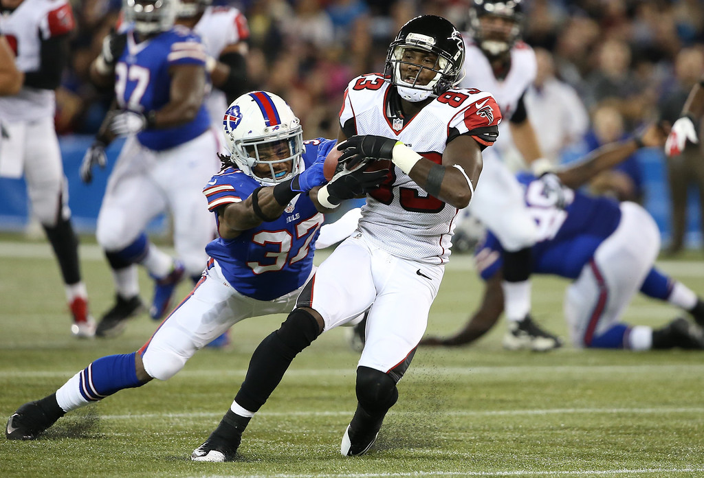 . Harry Douglas #83 of the Atlanta Falcons is tackled during an NFL game by Nickell Robey #37 of the Buffalo Bills at Rogers Centre on December 1, 2013 in Toronto, Ontario. (Photo by Tom Szczerbowski/Getty Images)