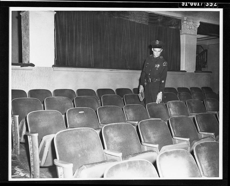 . With a police manhunt underway, Oswald had taken  refuge in Dallas\' Texas Theater, where police arrested him. An unknown police officer points to the seat in which Oswald sat. McClatchy-Tribune