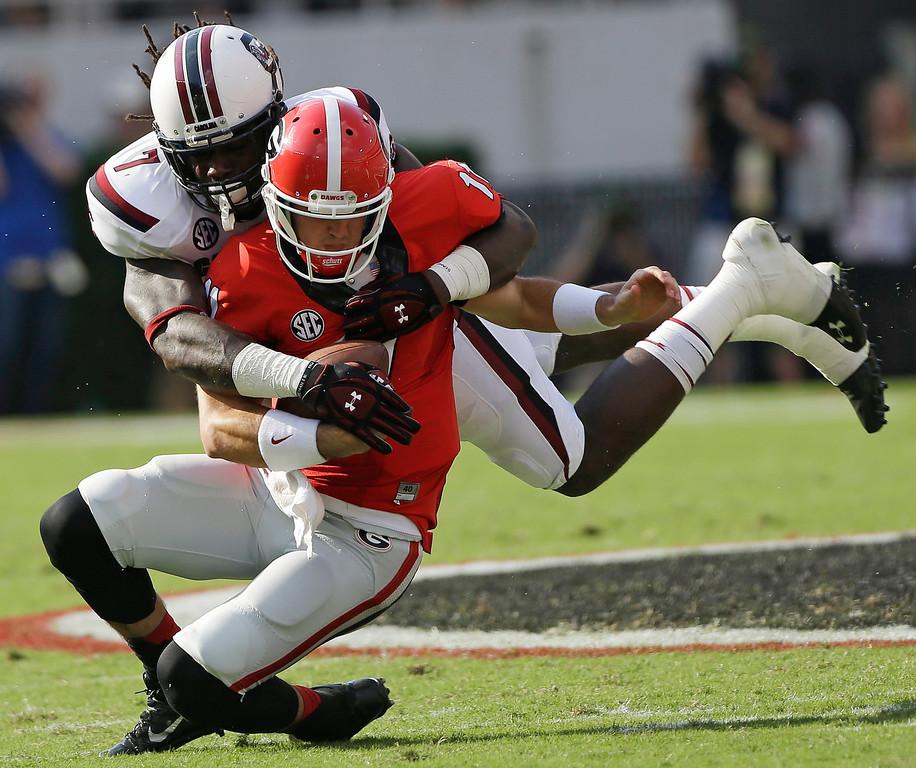 . South Carolina defensive end Jadeveon Clowney (7) tackles Georgia quarterback Aaron Murray (11) during the first half of an NCAA football game, Saturday, Sept. 7, 2013, in Athens, Ga. (AP Photo/John Bazemore)