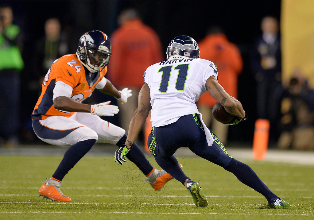 . Denver Broncos cornerback Champ Bailey (24) about to tackle Seattle Seahawks wide receiver Percy Harvin (11) during the first quarter. The Denver Broncos vs the Seattle Seahawks in Super Bowl XLVIII at MetLife Stadium in East Rutherford, New Jersey Sunday, February 2, 2014. (Photo by John Leyba/The Denver Post)